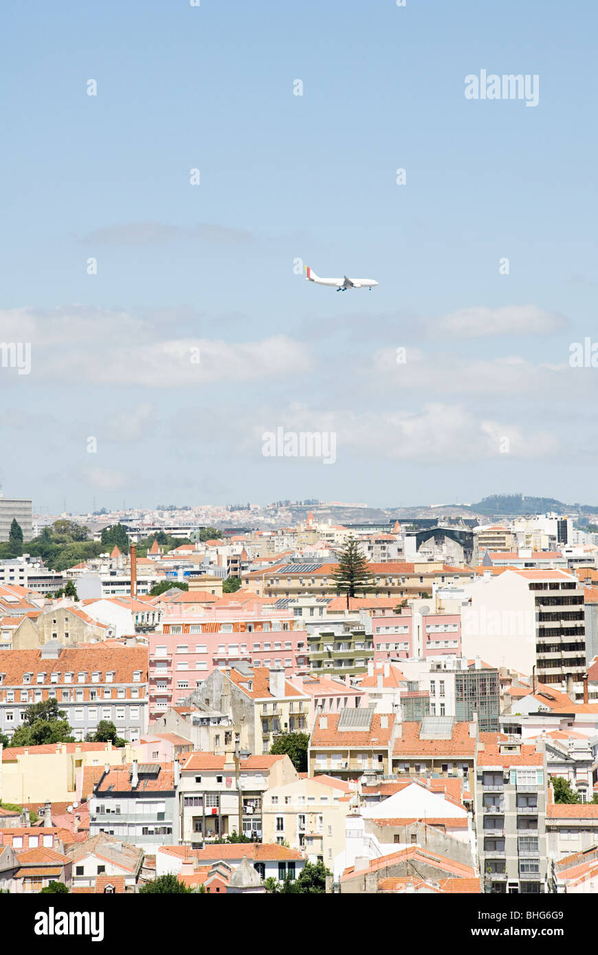 Airplane above lisbon - Stock Image