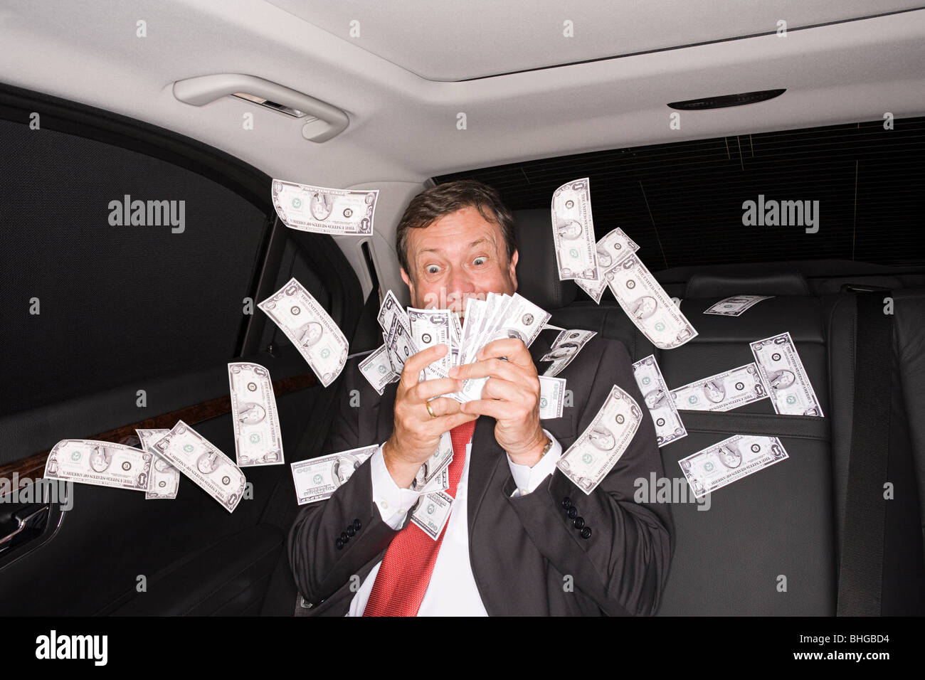 Wealthy businessman in the back of a car - Stock Image