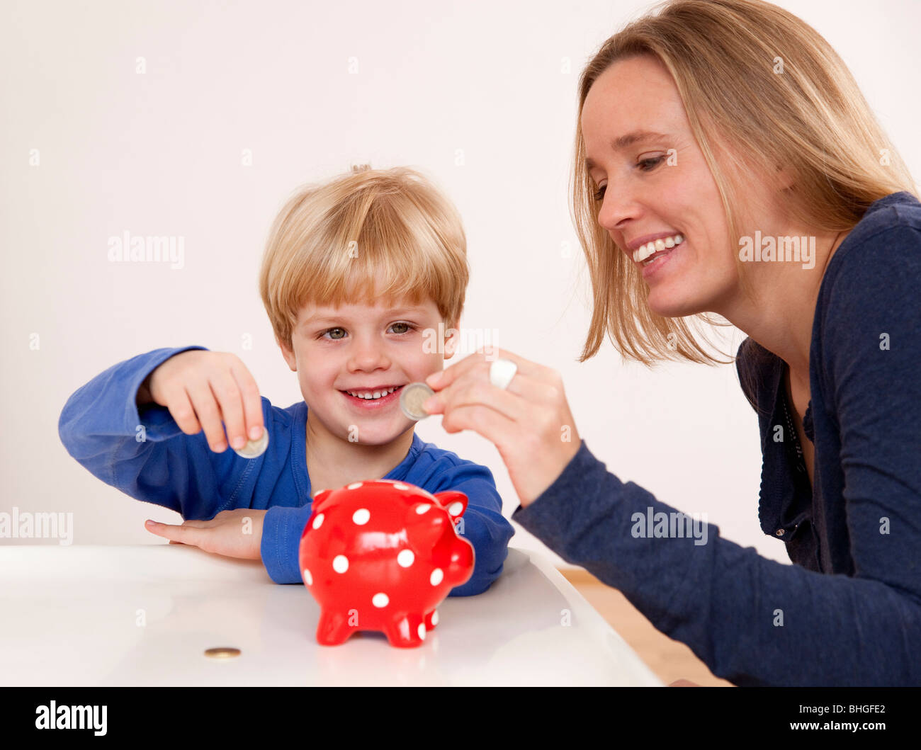 mother and son saving - Stock Image