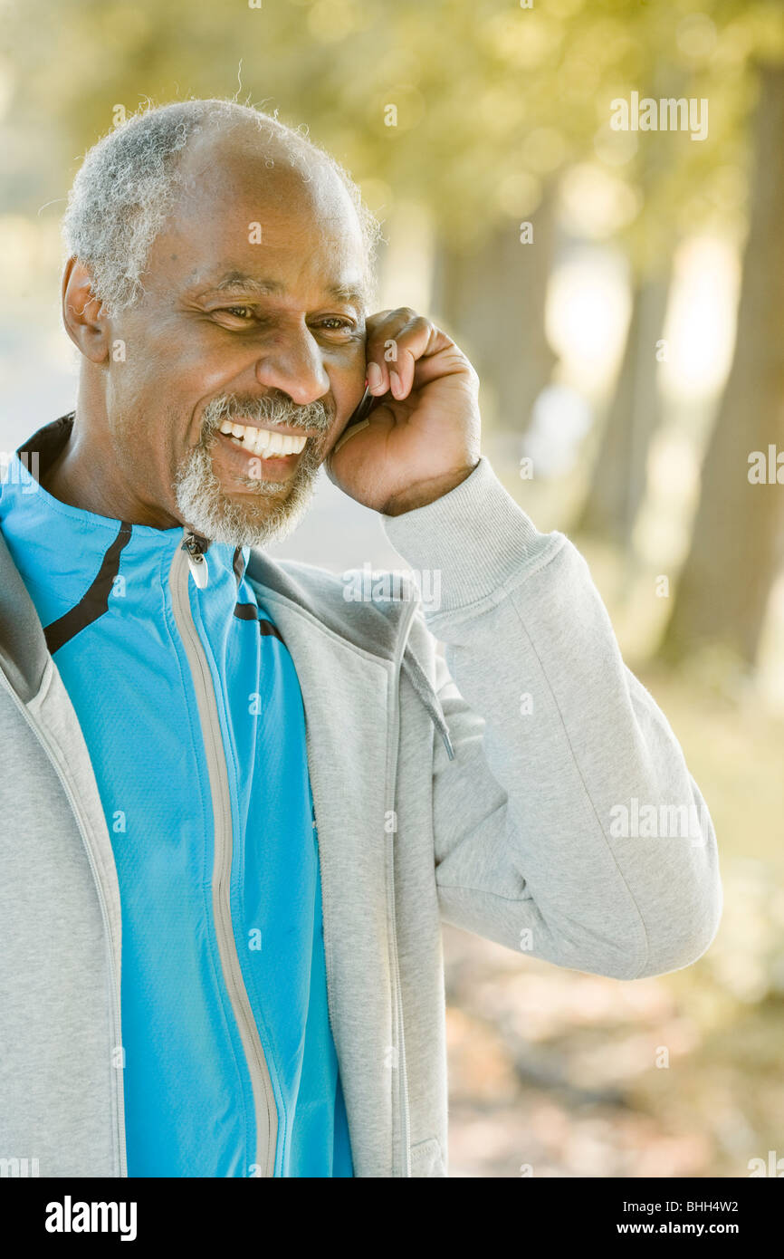 Senior man using a mobile phone, Sweden. Stock Photo
