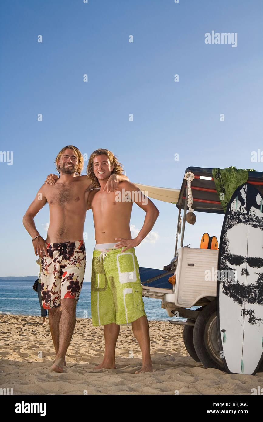surf men portrait by jeep - Stock Image