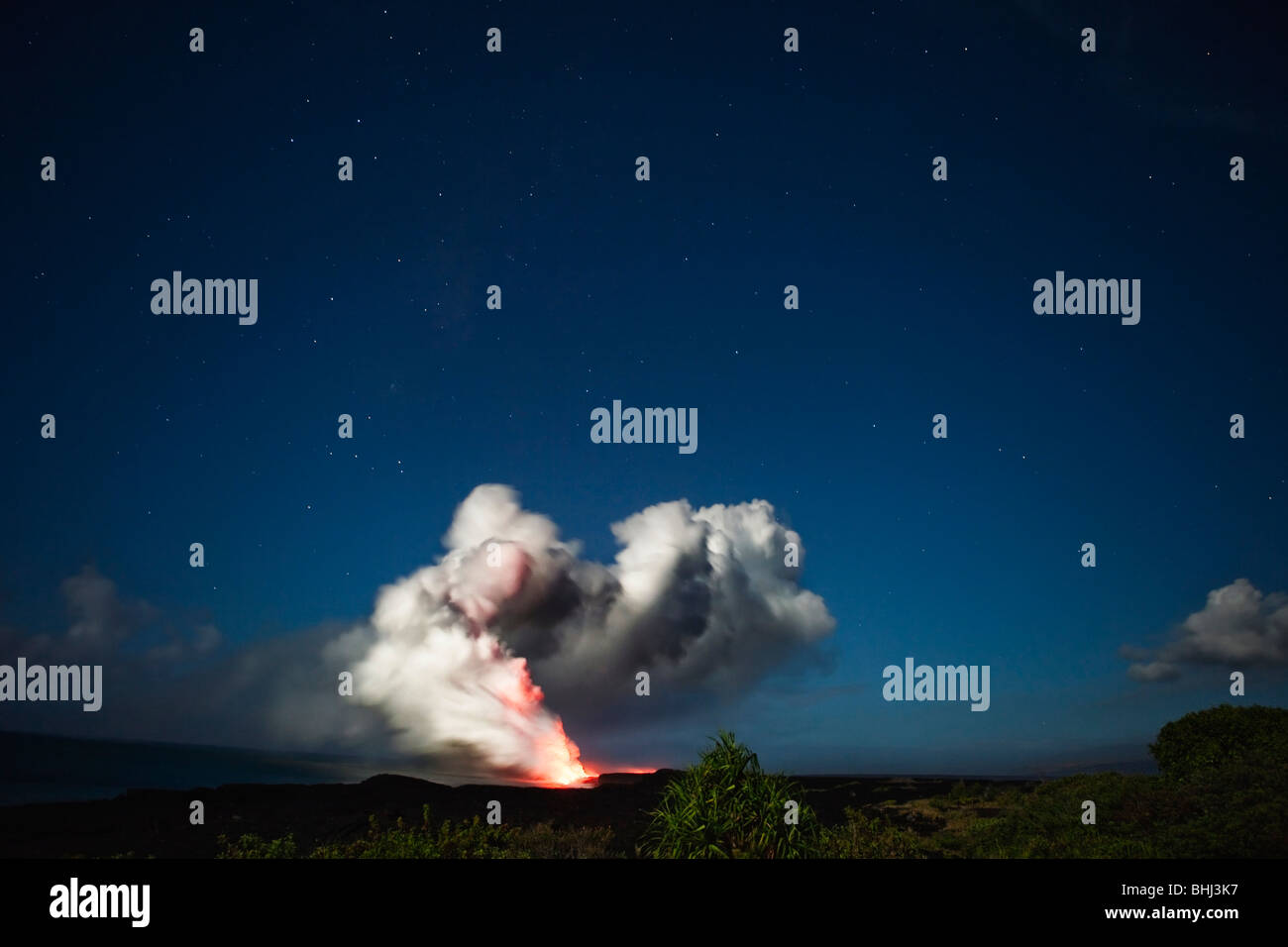 Ash and steam cloud from volcanic flow - Stock Image