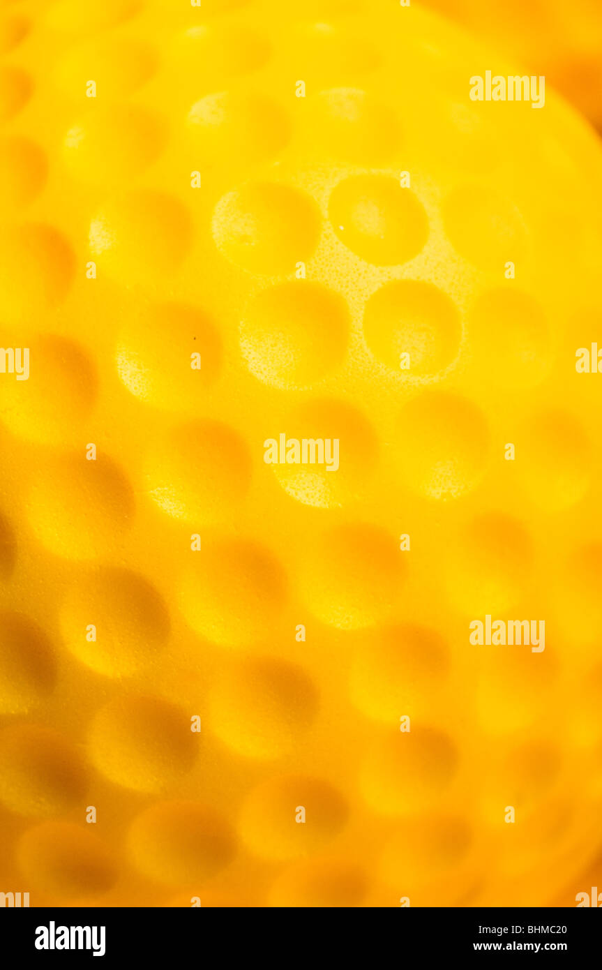 macro detail of a yellow golf ball - Stock Image