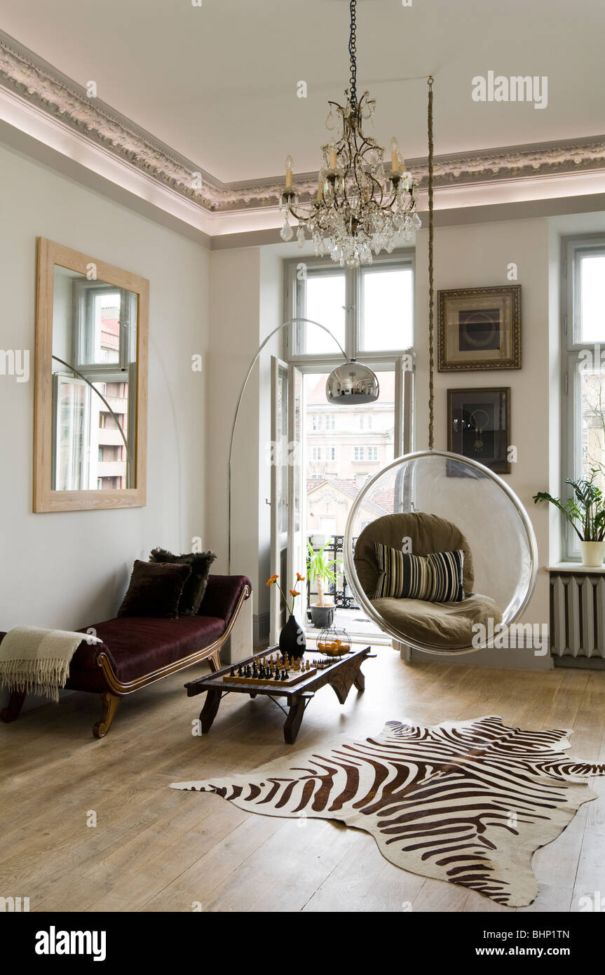 Eero Aarnio bubble chair in living room with zebra skin rug and ...