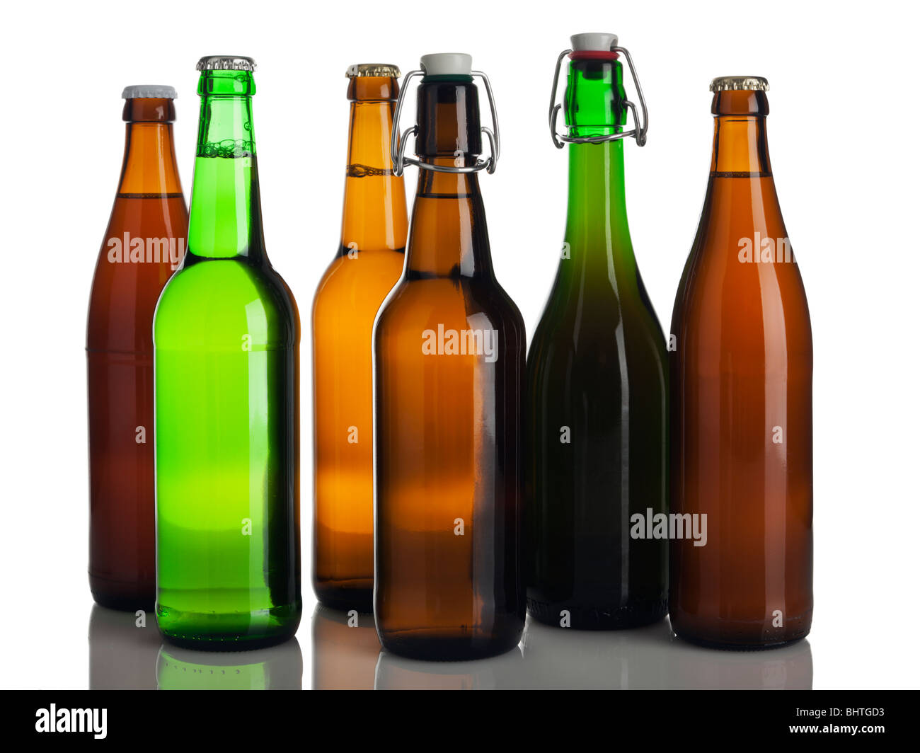 six different bottles of beer without labels isolated on white - Stock Image