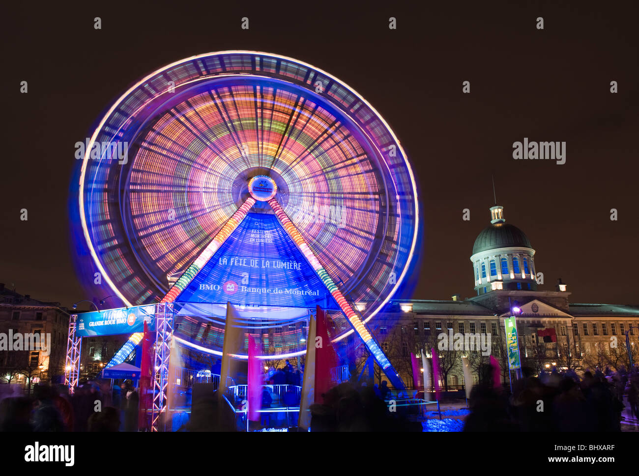 BMO ferris wheel with Bonsecours Market in the background. Old Montreal, Quebec, Canada. - Stock Image