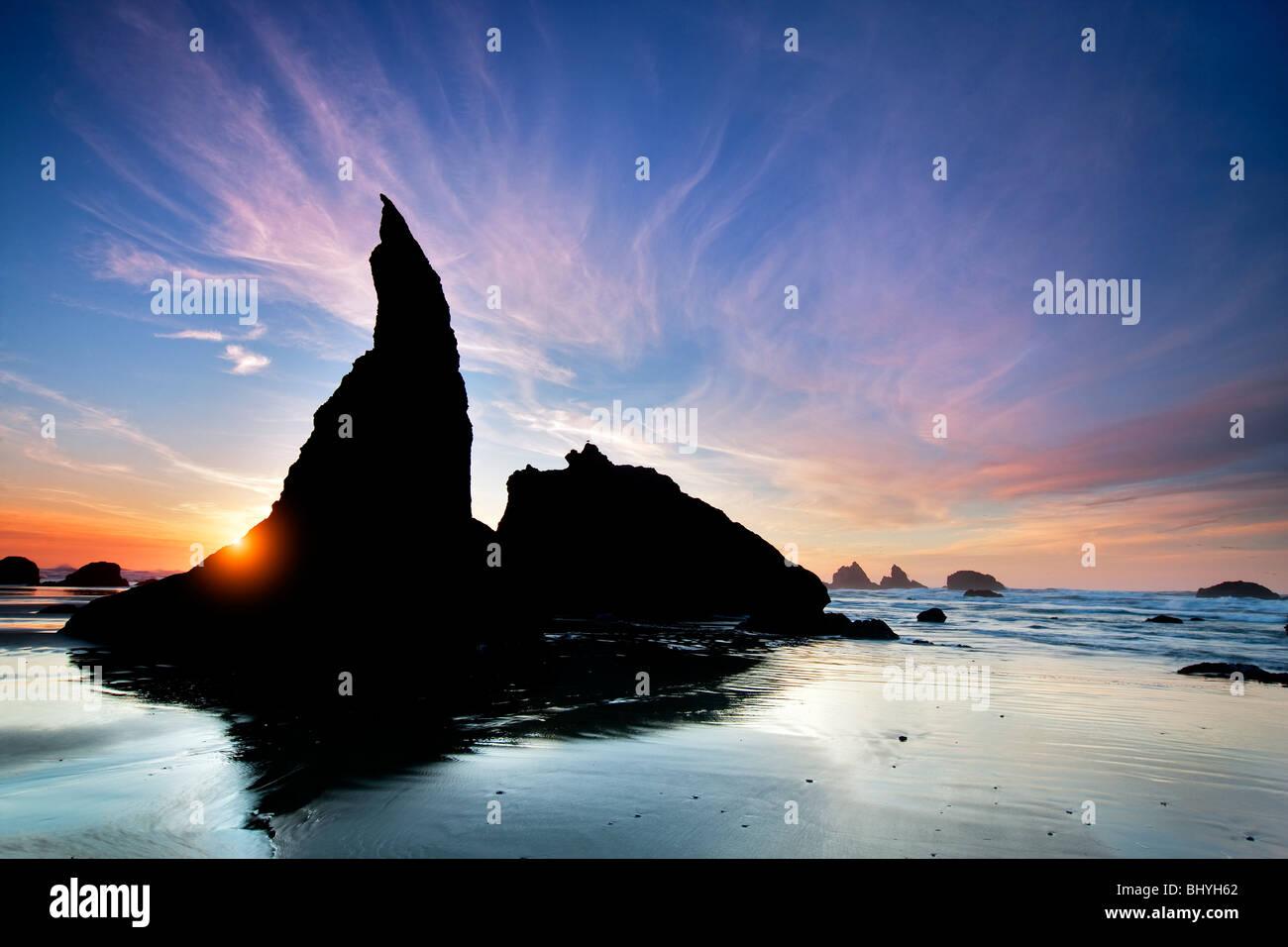 Sea stacks and sunset at Bandon Beach at low tide. Oregon - Stock Image