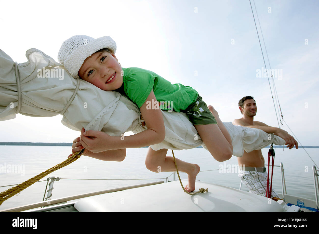 young girl and father on sailing ship - Stock Image