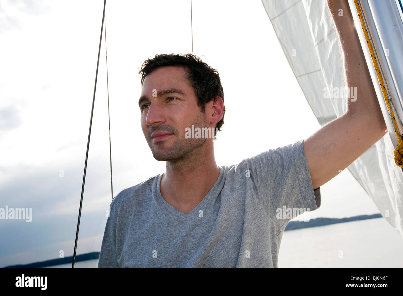portrait of man on sailing ship - Stock Image