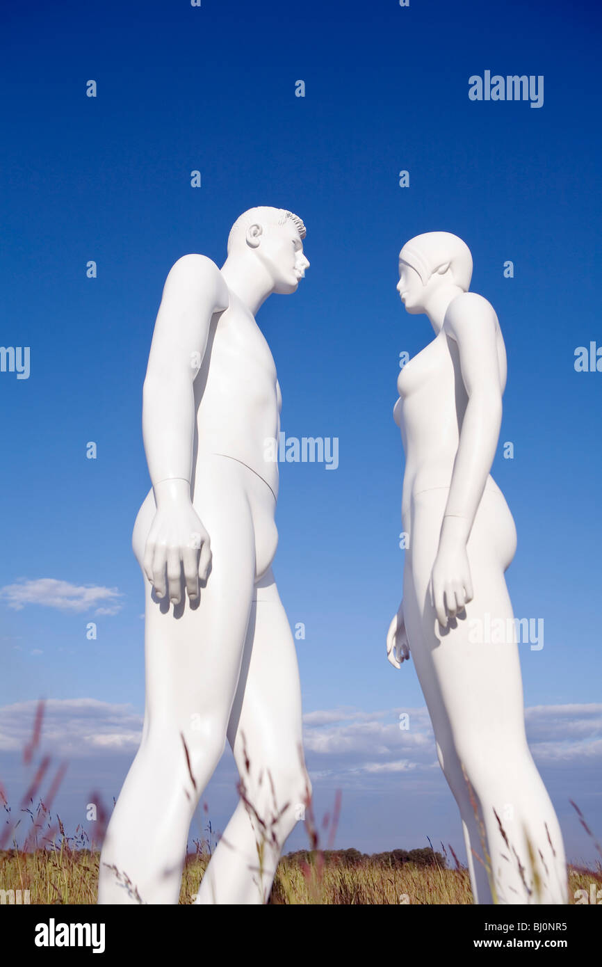 two white mannequins standing face to face - Stock Image
