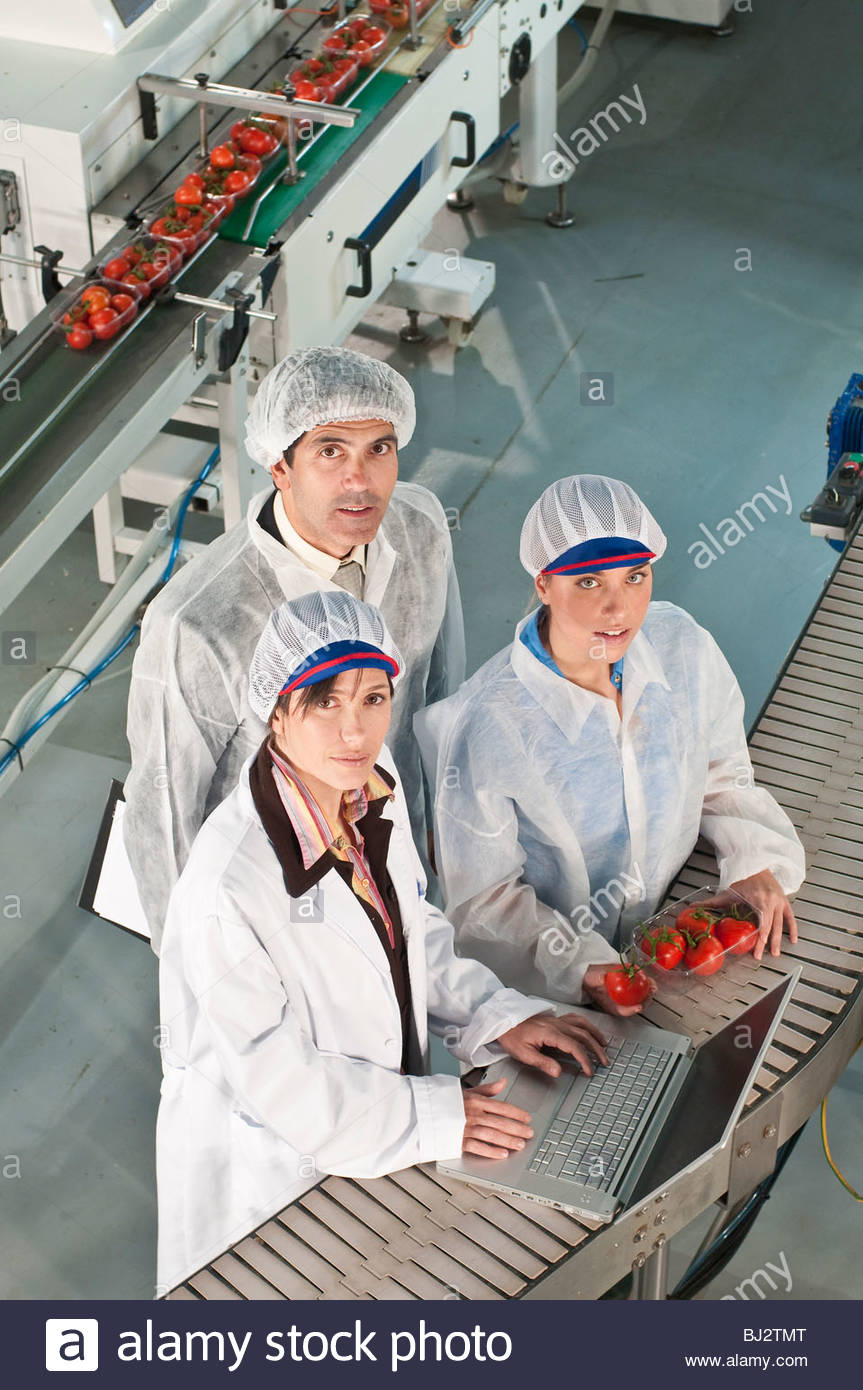 workers in food production facility - Stock Image