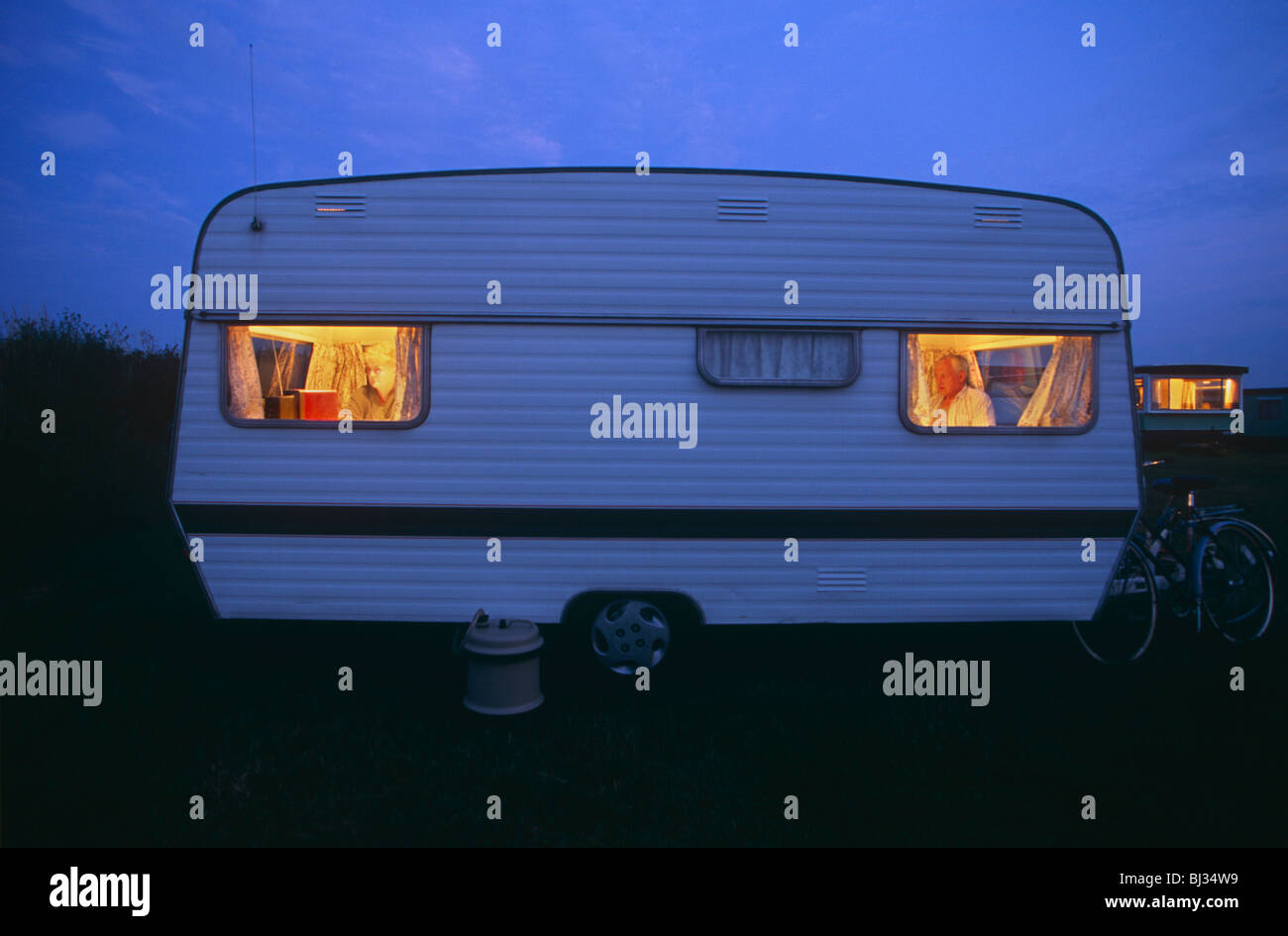 warm-orange-glow-of-two-caravan-campers-