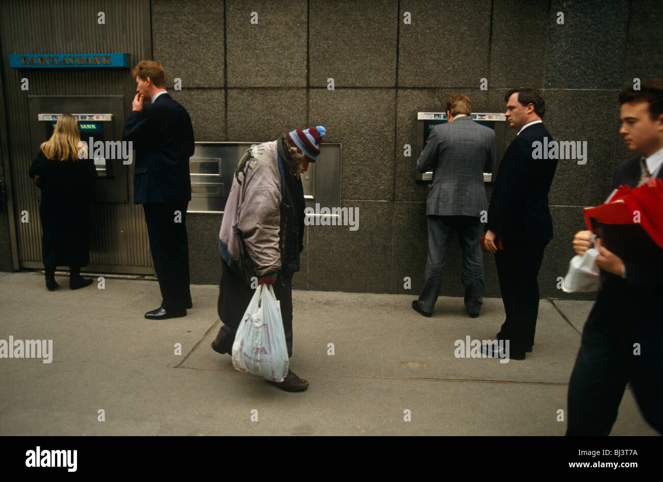 an-elderly-homeless-man-shuffles-past-a-