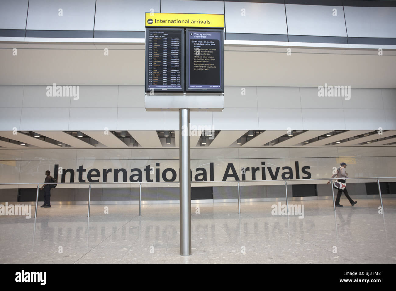 Heathrow Airport's terminal 5 international arrivals - Stock Image