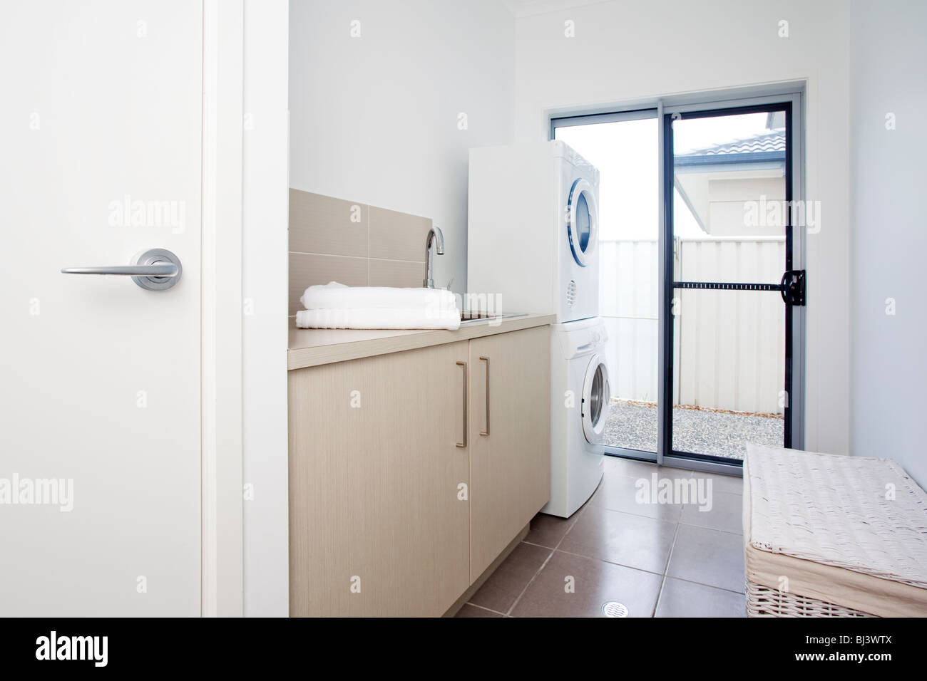 laundry room in modern townhouse - Stock Image