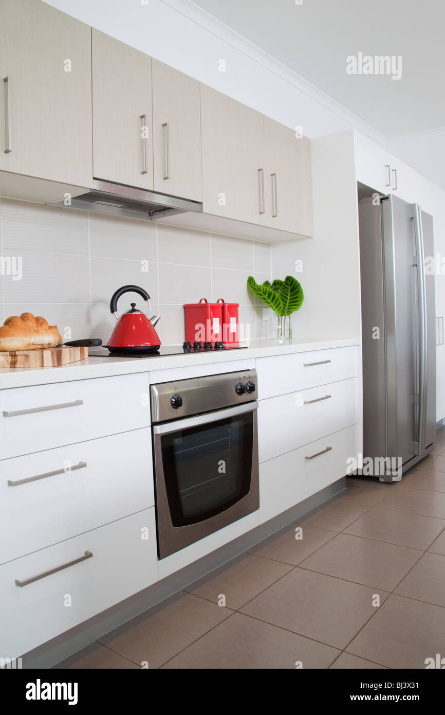 Kitchen in new modern townhouse - Stock Image