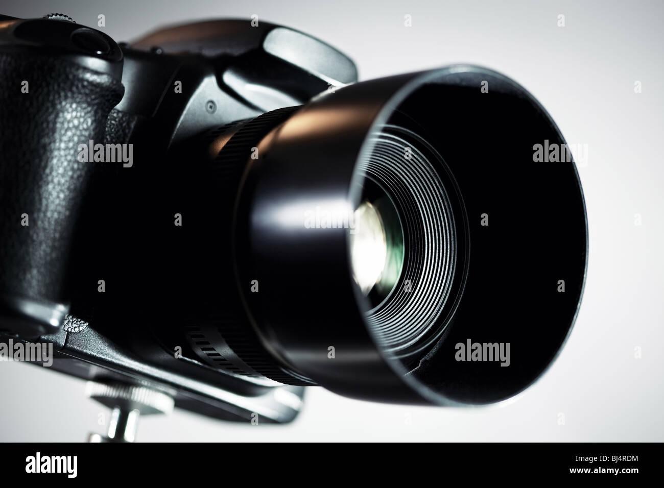 Professional DSLR camera on grey background. - Stock Image