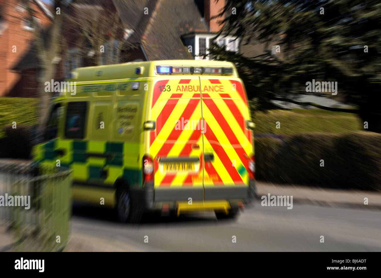An ambulance going away with blur, UK - Stock Image