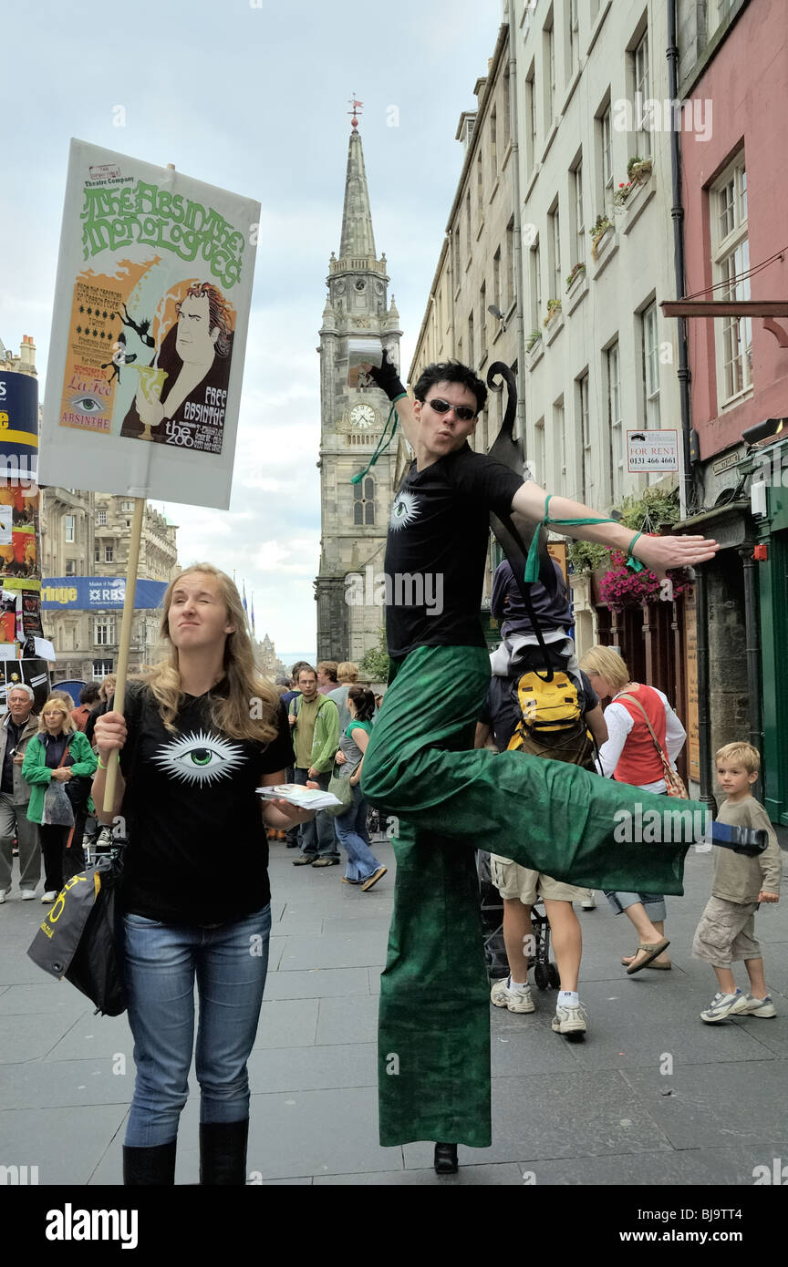 "Actor from ""The Absinthe Monologues"" at the Edinburgh Festival Fringe walks along the Royal Mile wearing stilts Stock Photo"