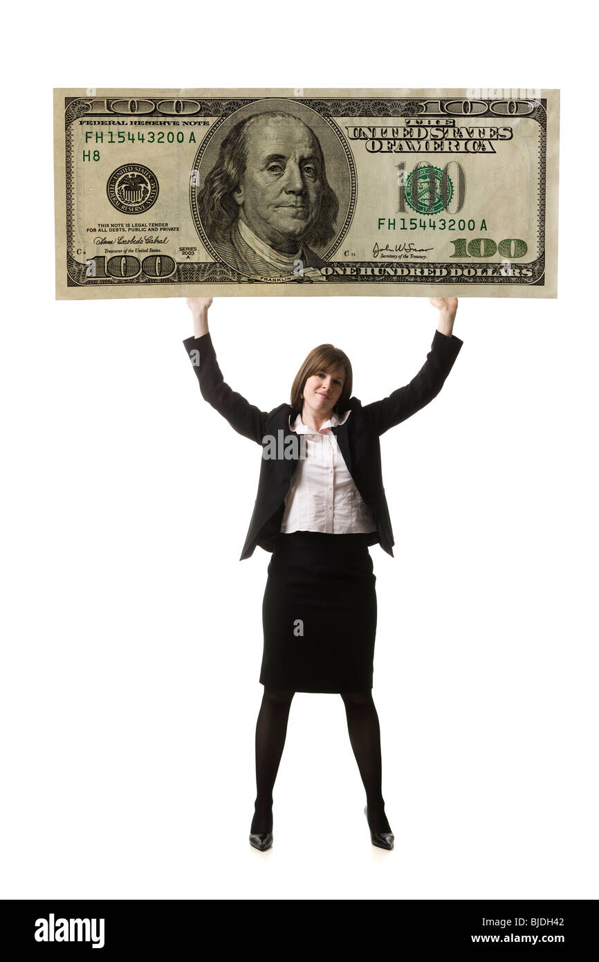 businessperson holding up a bank note - Stock Image