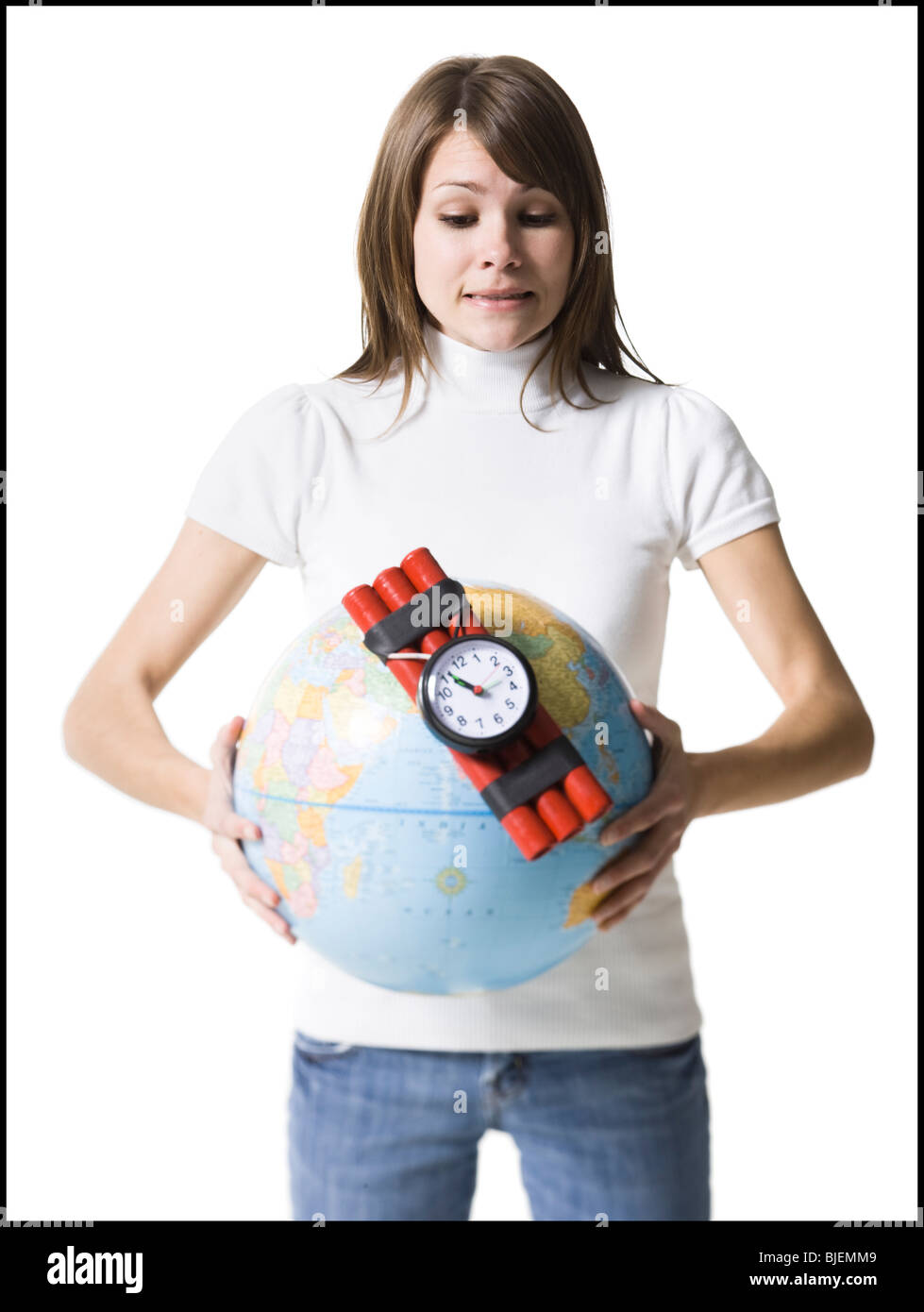 woman holding dynamite on the earth - Stock Image