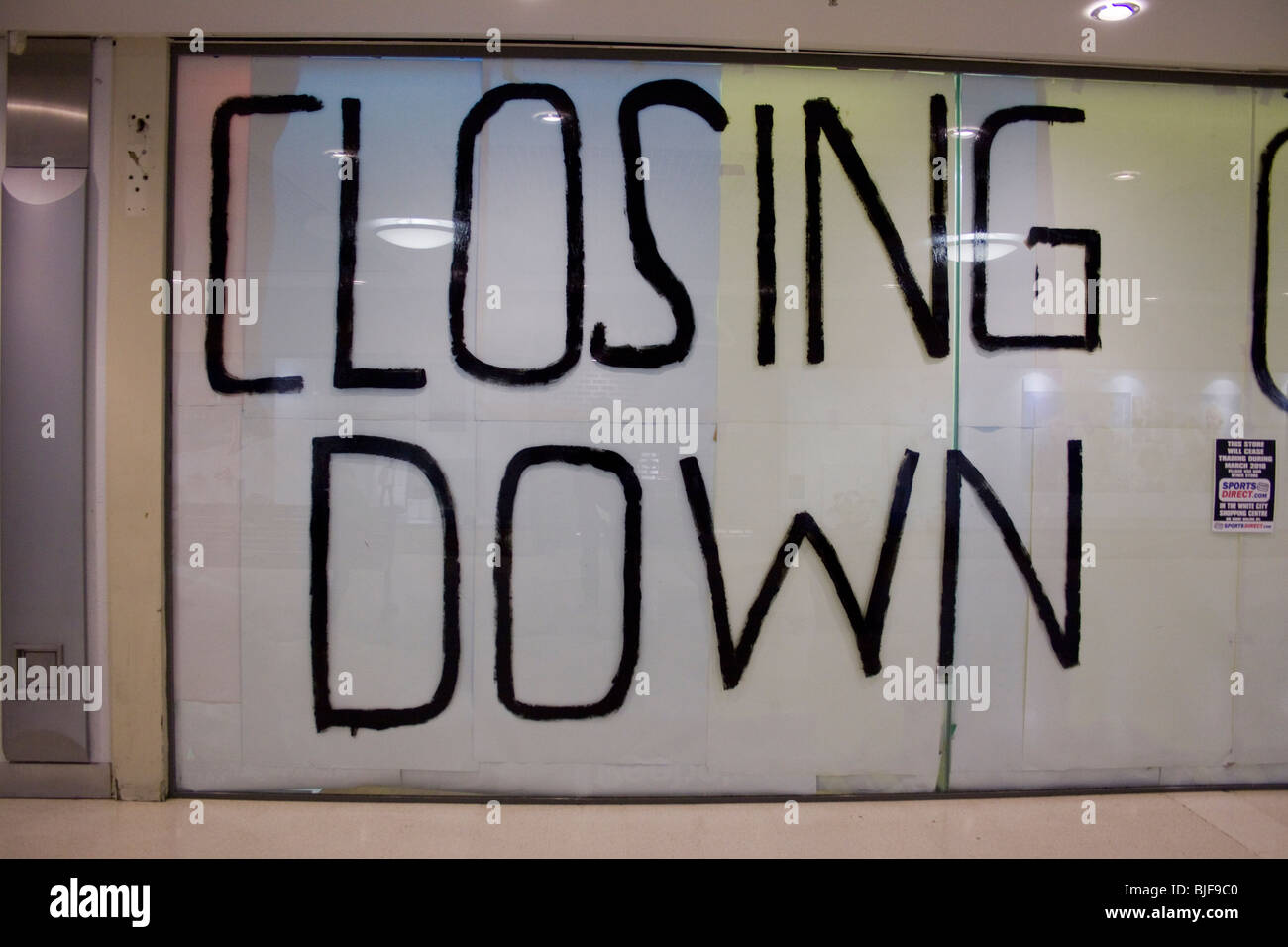Closing Down written in big letters on a shop window Stock Photo