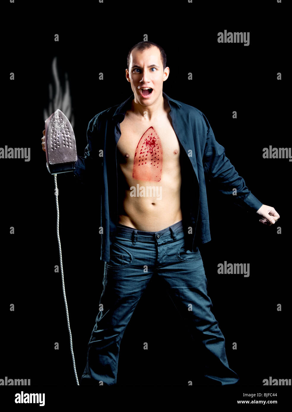 Crazy man with a hot burn on the chest - Stock Image