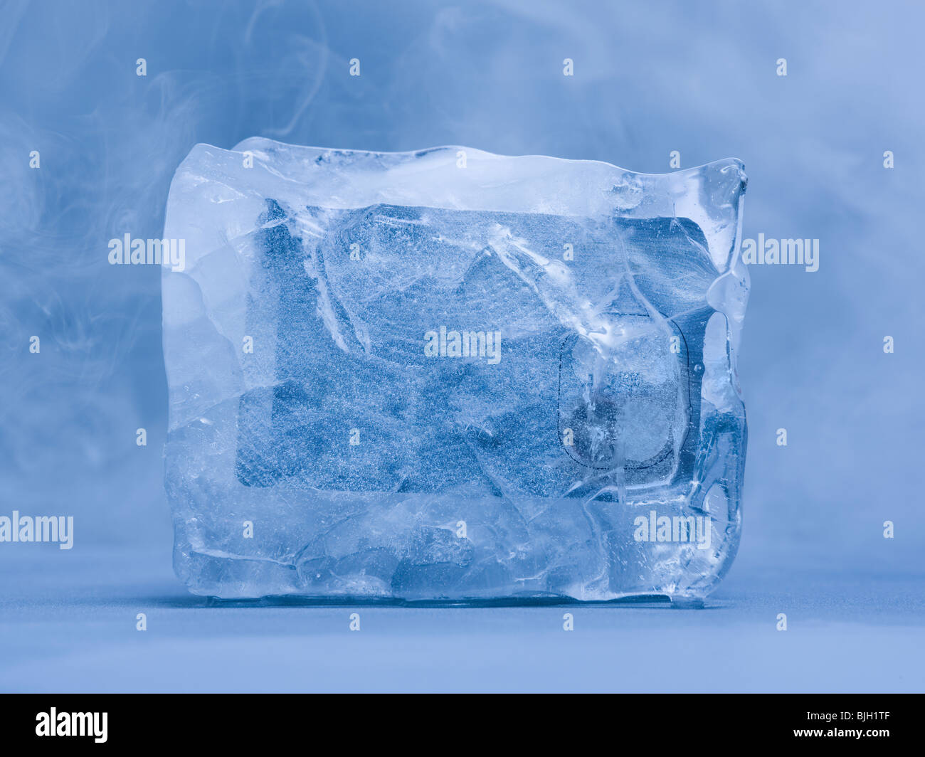 credit card frozen in ice - Stock Image