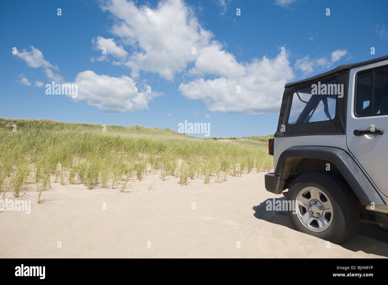 Jeep on the beach - Stock Image