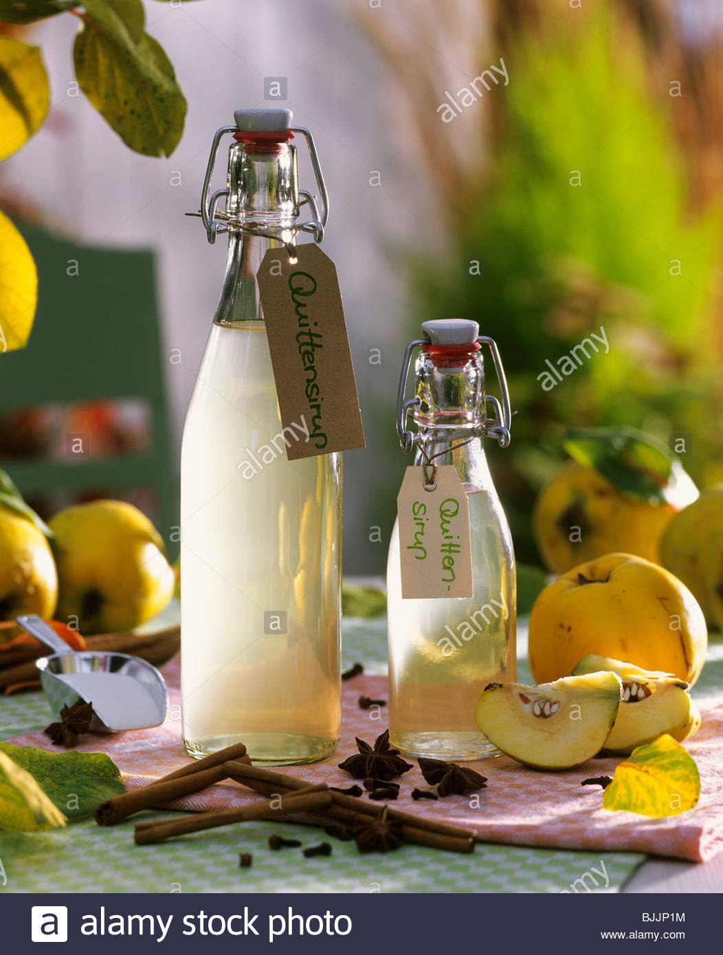 Quince syrup in flip-top bottles - Stock Image
