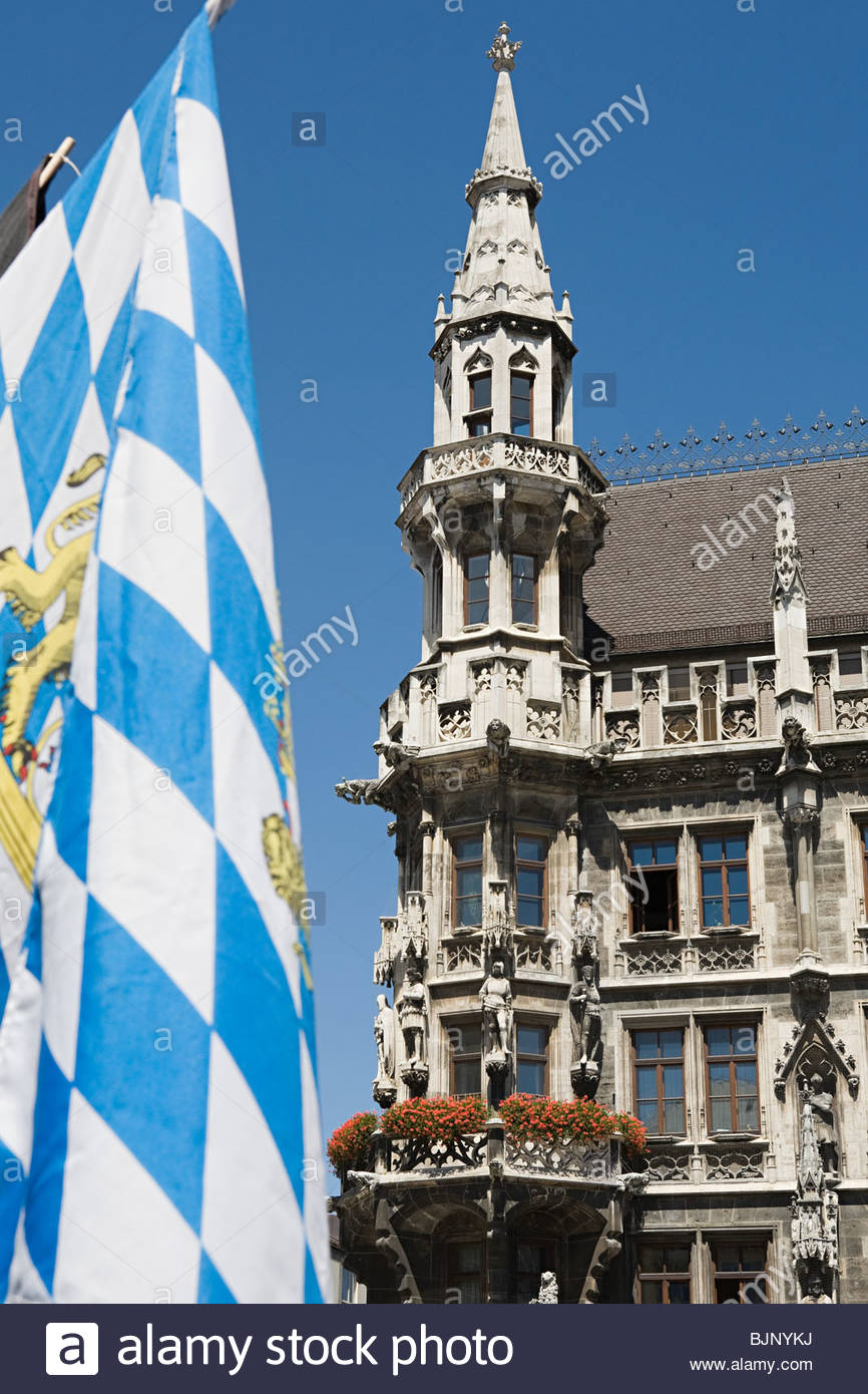 Bavarian flag and munich town hall - Stock Image