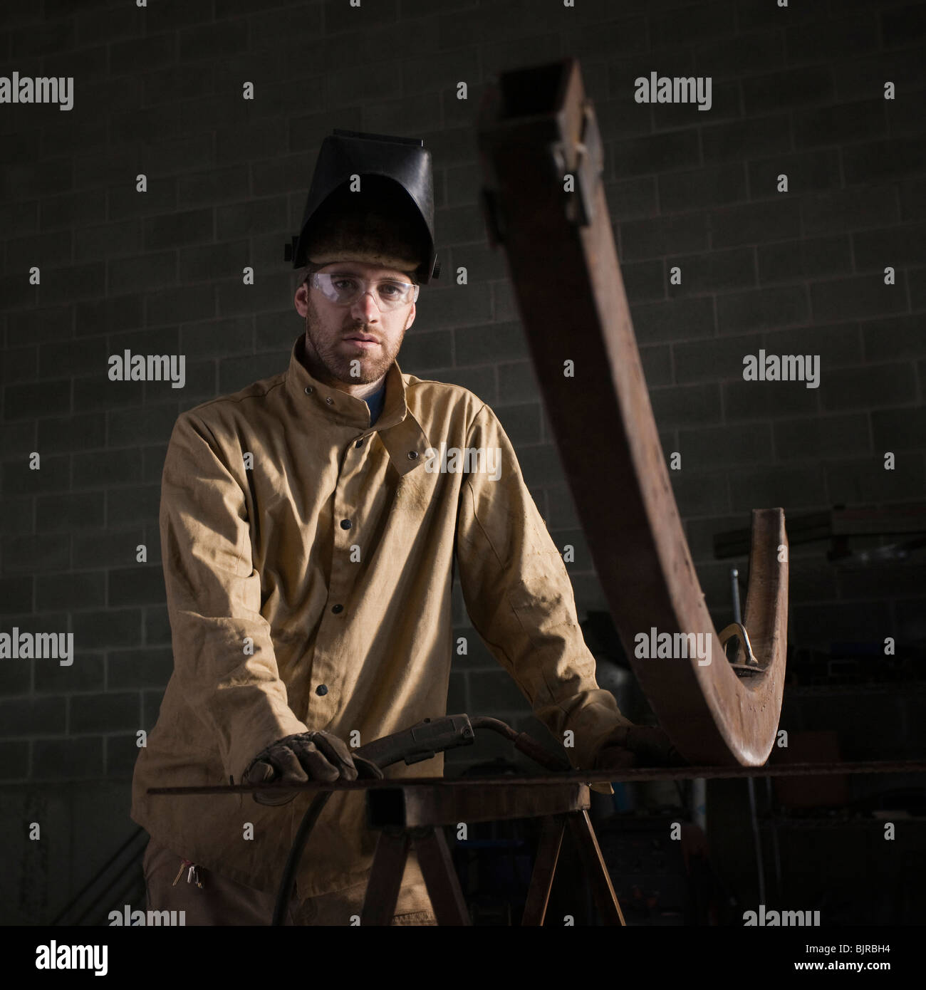 USA, Utah, Orem, portrait of male welder in workshop - Stock Image