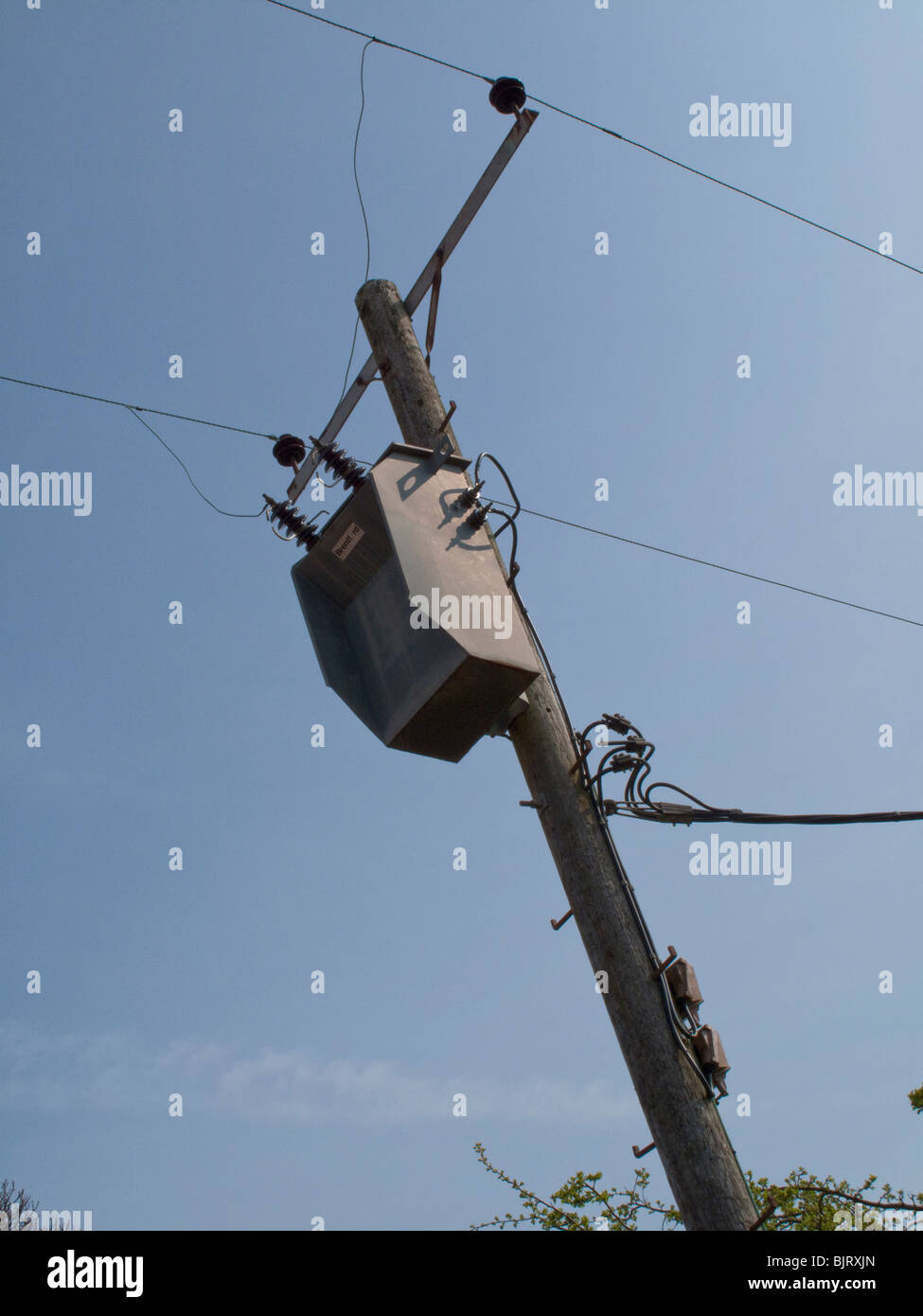 WOODEN POWER CABLE POLE AND TRANSFORMER. - Stock Image