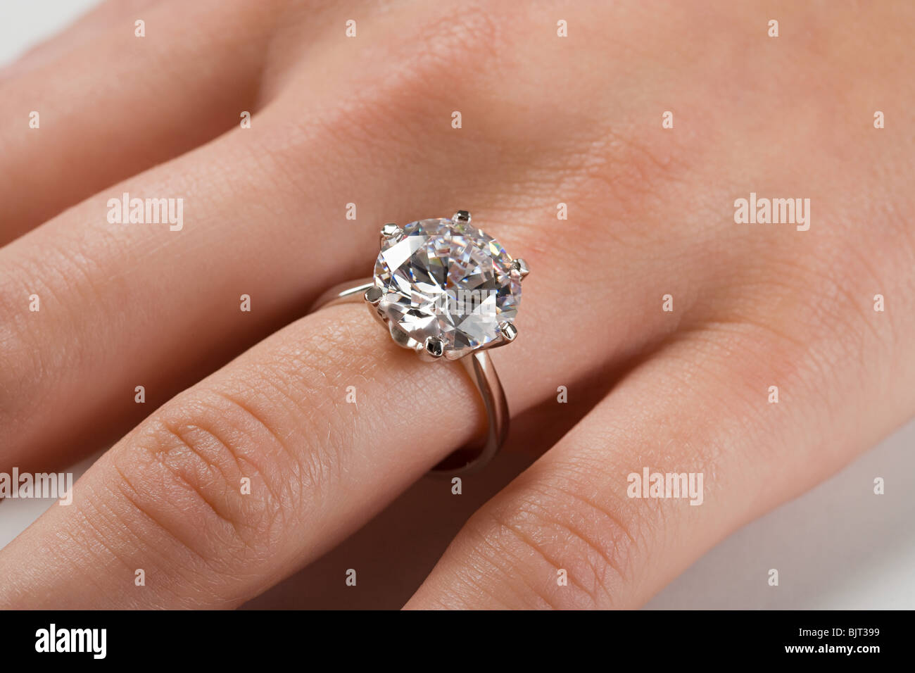 A woman wearing an engagement ring Stock Photo