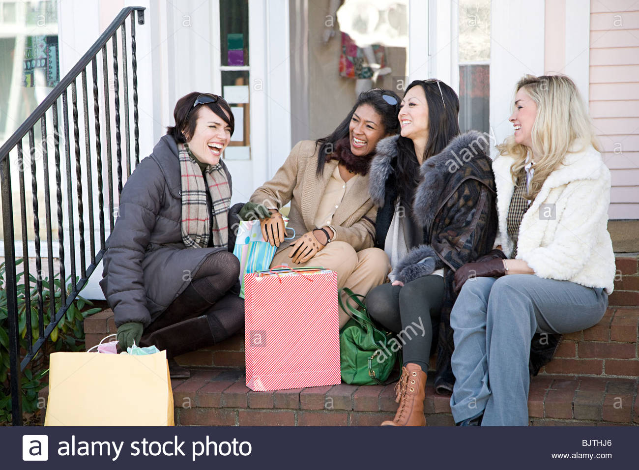 Friends with shopping bags - Stock Image