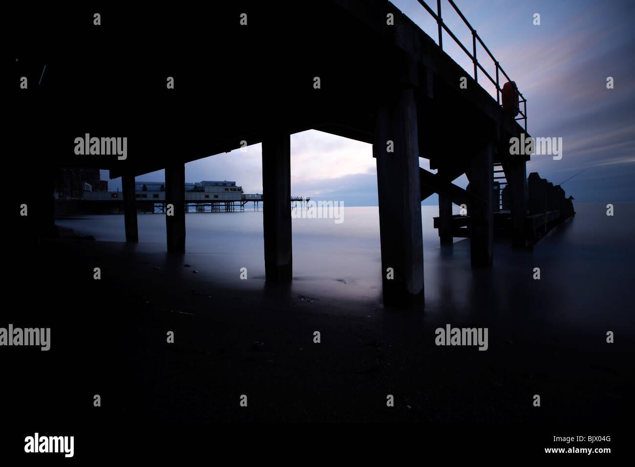 Aberystwyth pier, promenade and seashore at dusk, long exposure image, Wales UK - Stock Image