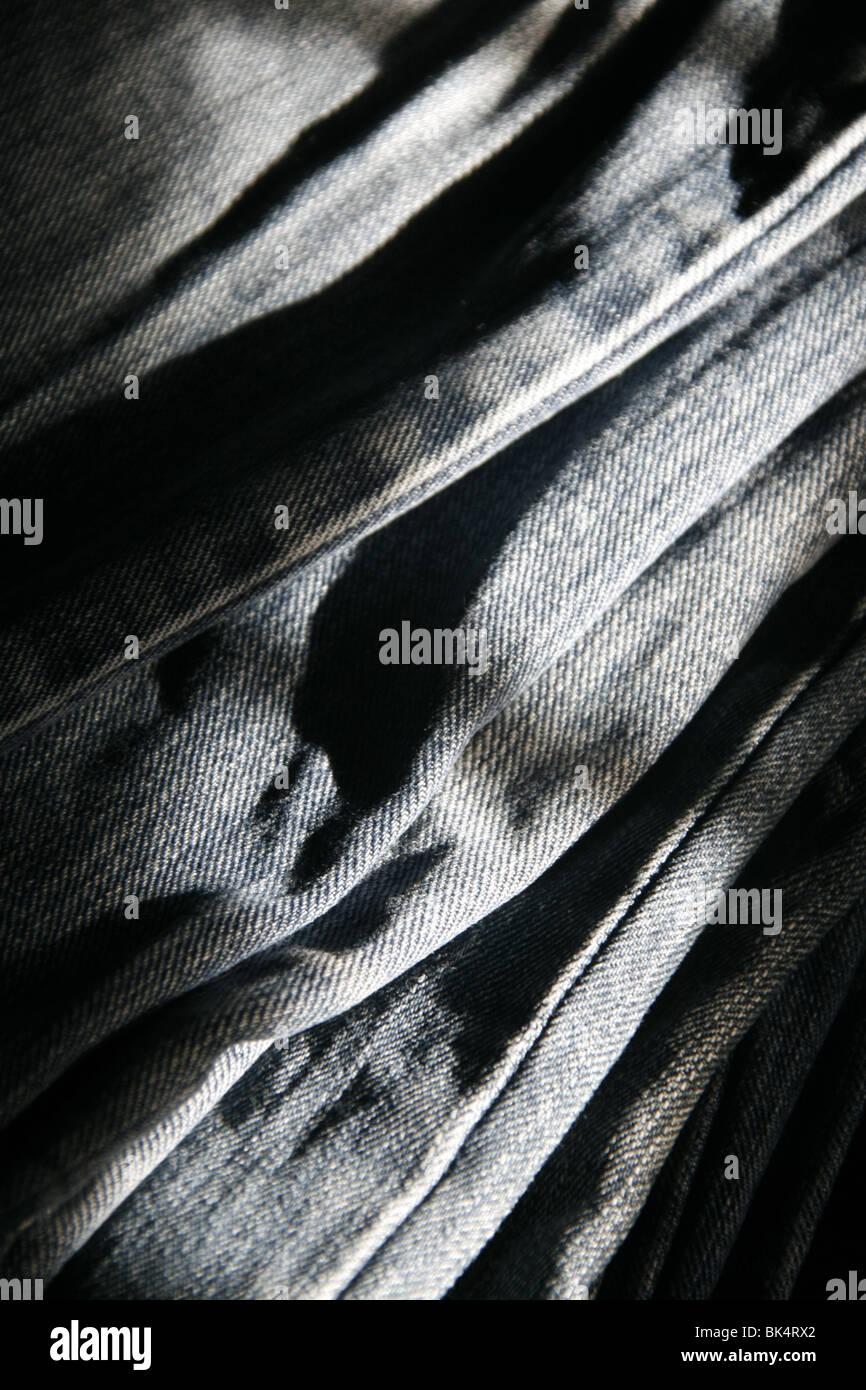 close up detail of blue denim jeans trousers pants Stock Photo