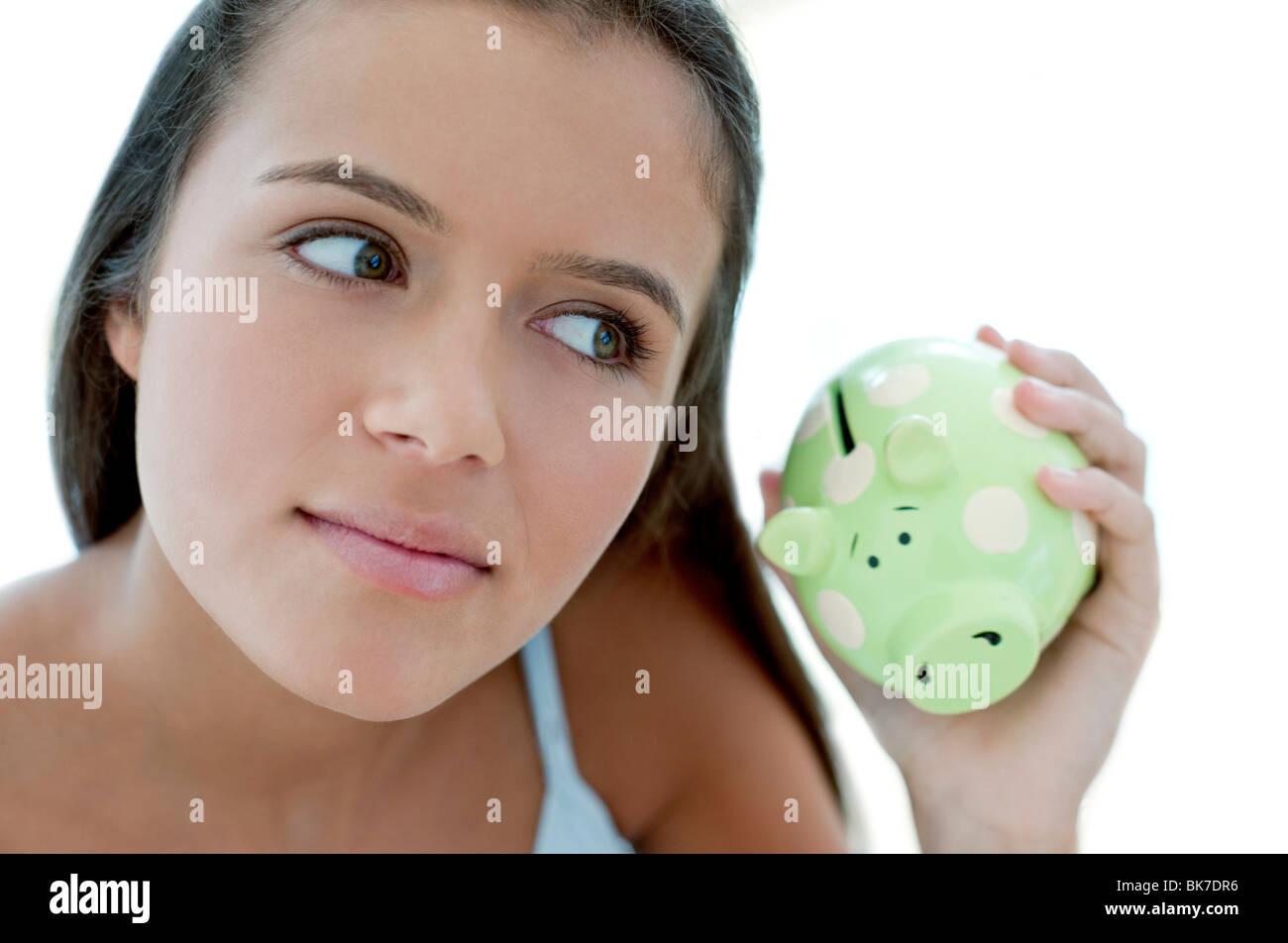 Teenage girl saving money - Stock Image