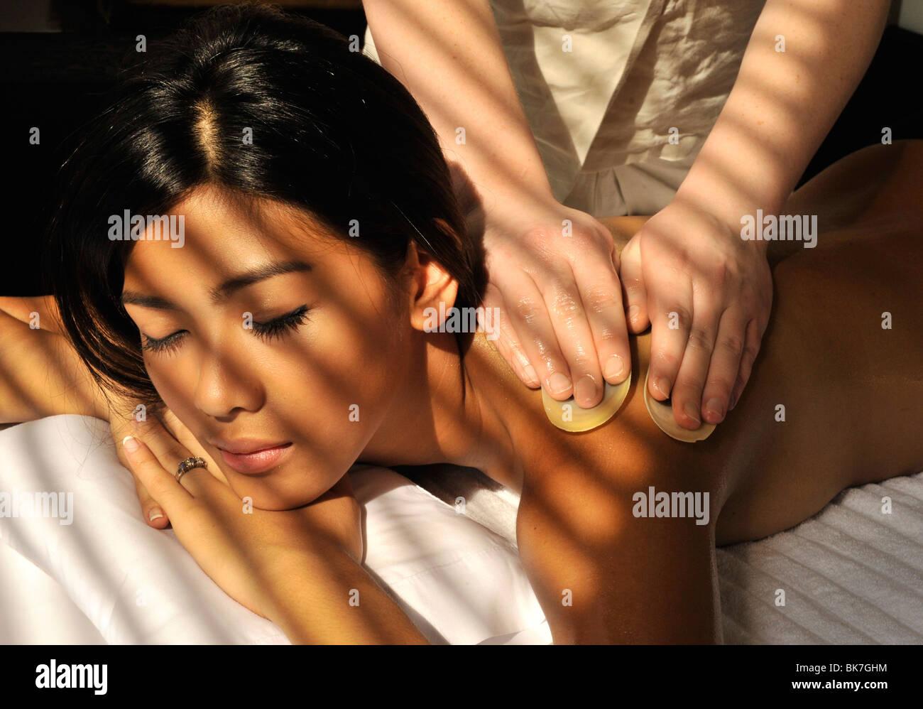 Coconut oil massage with shells, Le Spa at Sofitel Manila, Philippines, Southeast Asia, Asia - Stock Image