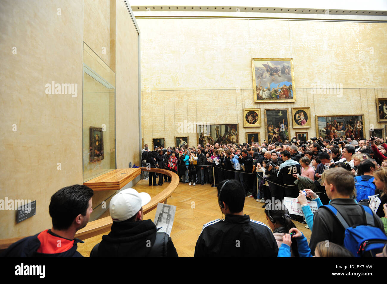 France Paris  Louvre museum art gallery  Mona Lisa room crowds of tourists try to see the famous painting Stock Photo