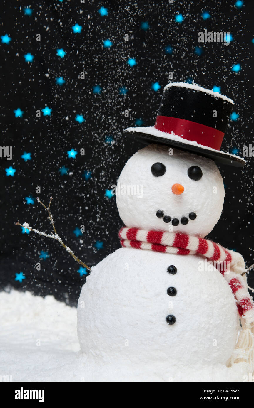 Snowman in the snow against starry night sky concept with copy space - Stock Image