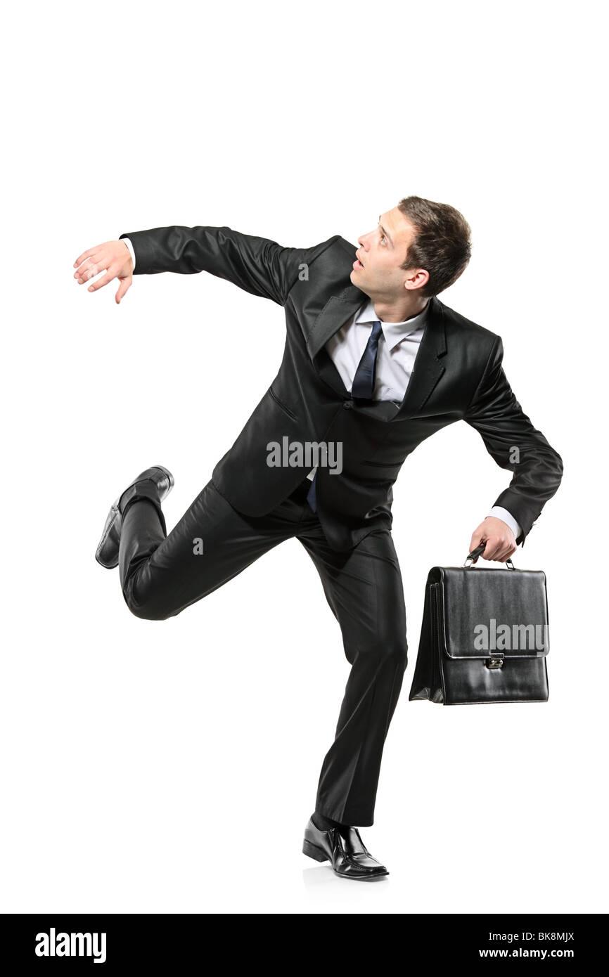 An afraid businessman running away Stock Photo