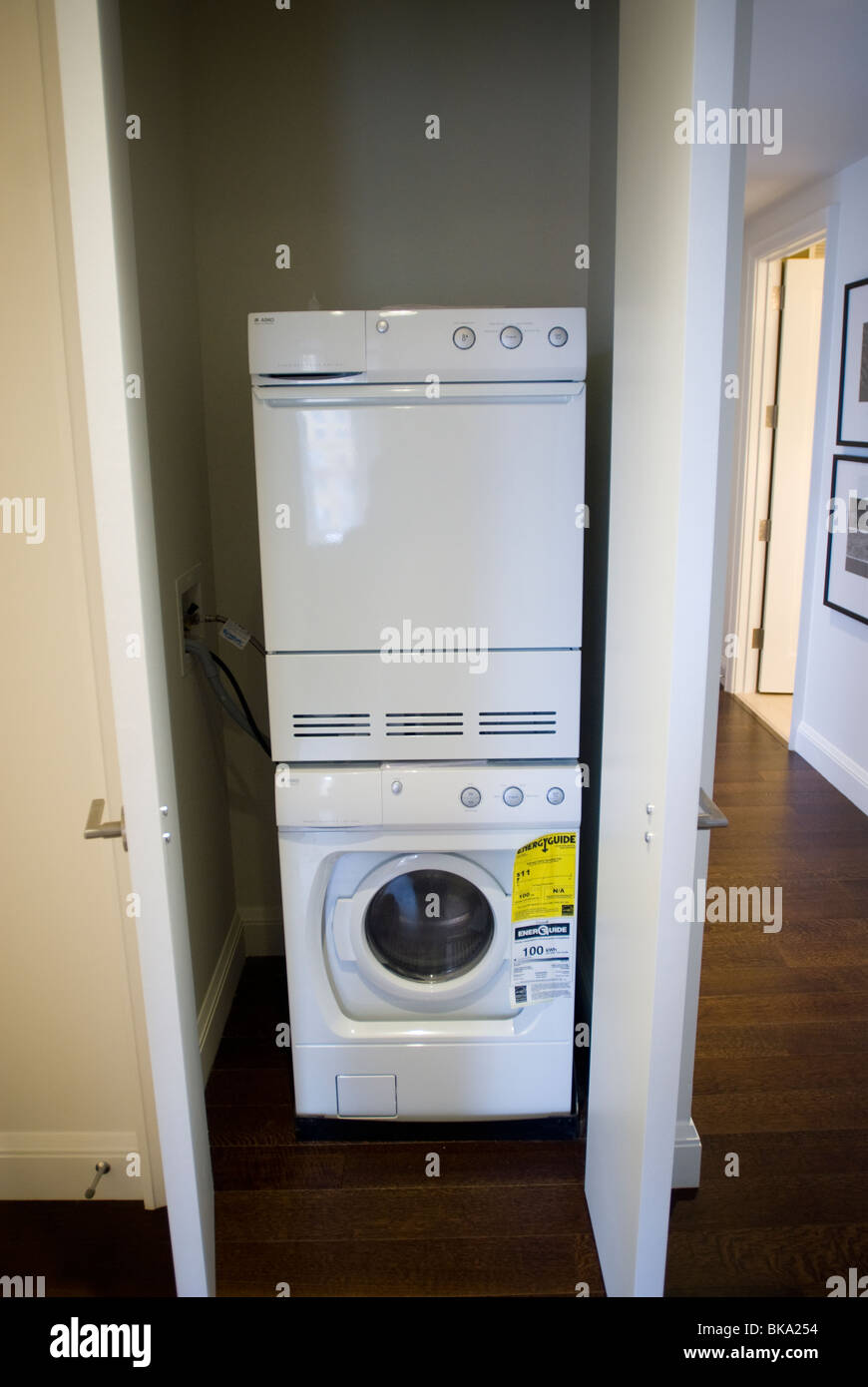 A washing machine and dryer squeezed into a closet in an apartment ...