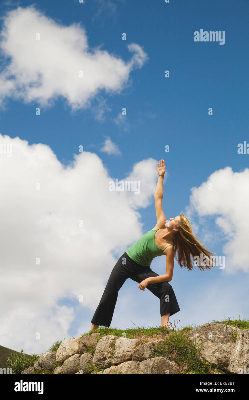 Woman Doing Yoga, Cuzco (Cusco), Peru - Stock Image