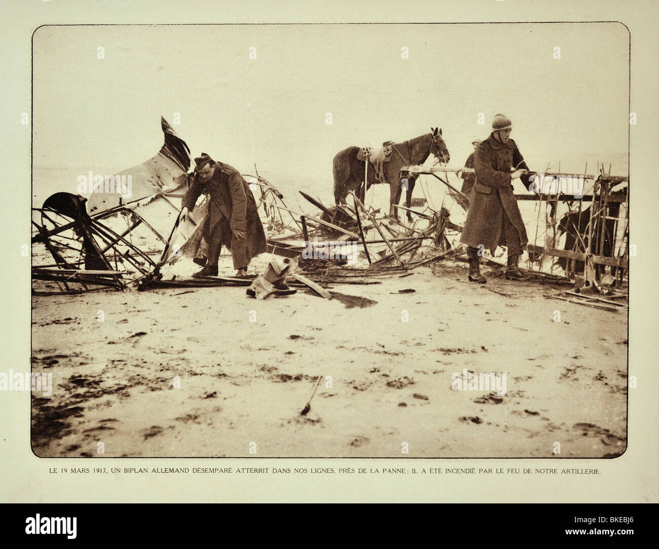 WW1 Belgian soldiers examining crashed biplane near De Panne, West Flanders during the First World War One, Belgium - Stock Image