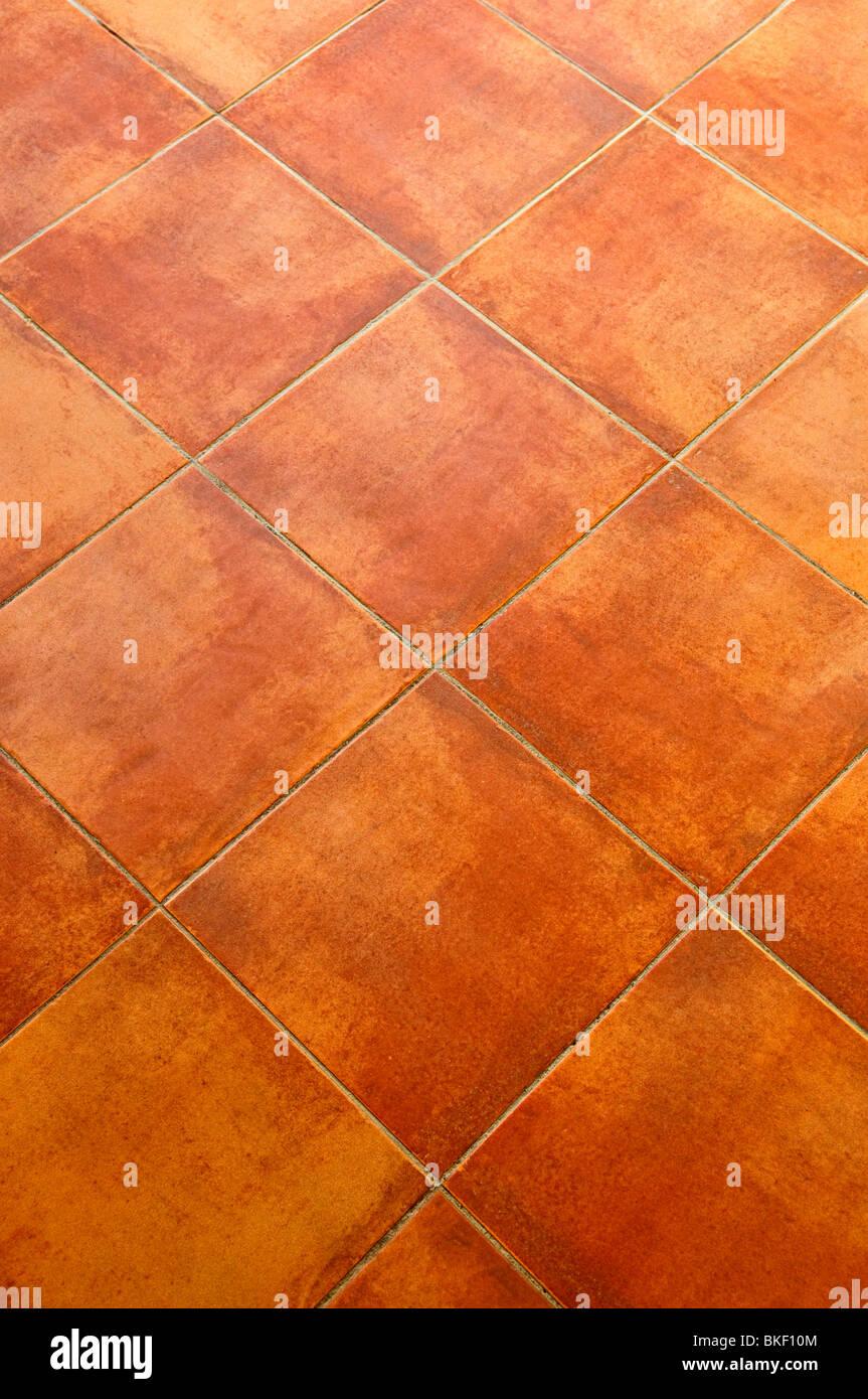 Closeup of square terracotta ceramic tile floor background stock closeup of square terracotta ceramic tile floor background dailygadgetfo Image collections
