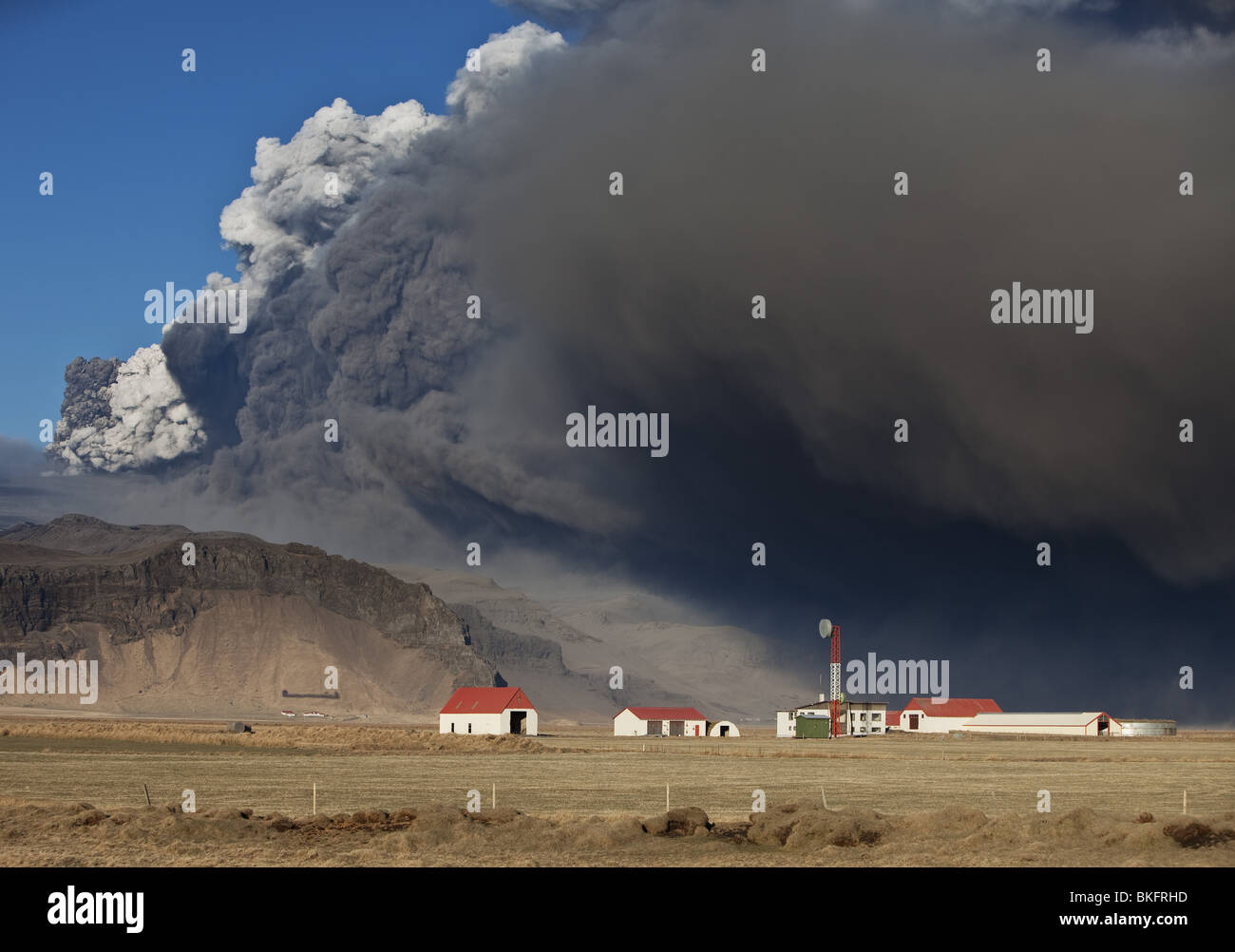 Farm with Volcanic Ash Cloud from Eyjafjallajokull Volcano Eruption, Iceland. - Stock Image