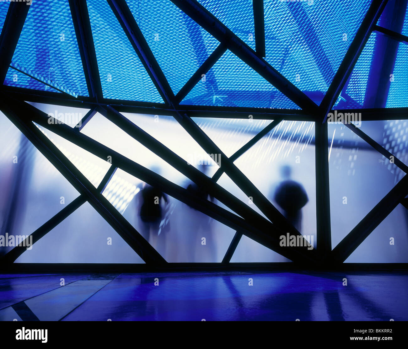 Silhouettes of people in front of futuristically designed pavilion at the Zaragoza, Spain. - Stock Image
