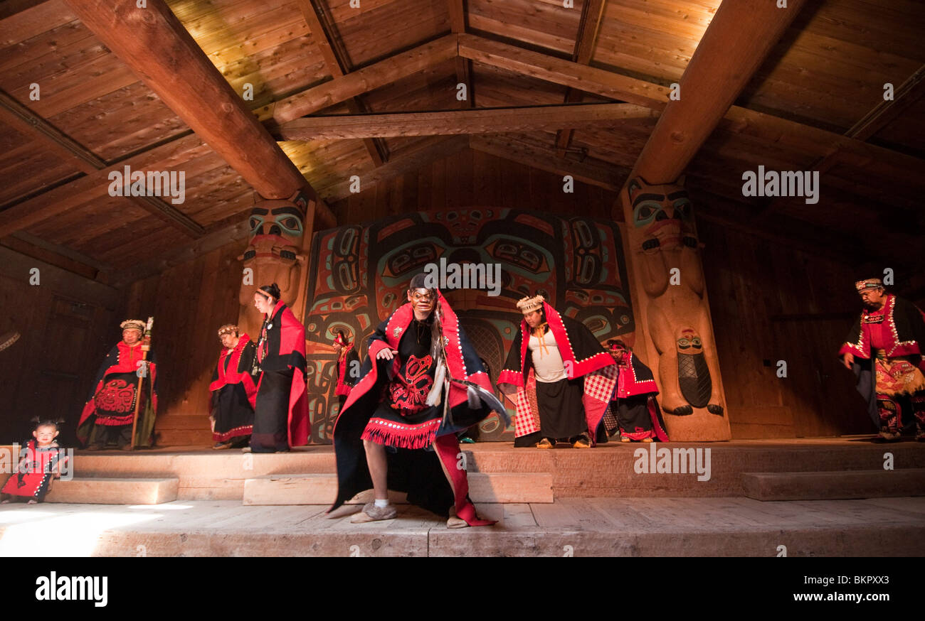 Tlingit native dancers at the Saxman Village clan house, Ketchikan, Alaska - Stock Image