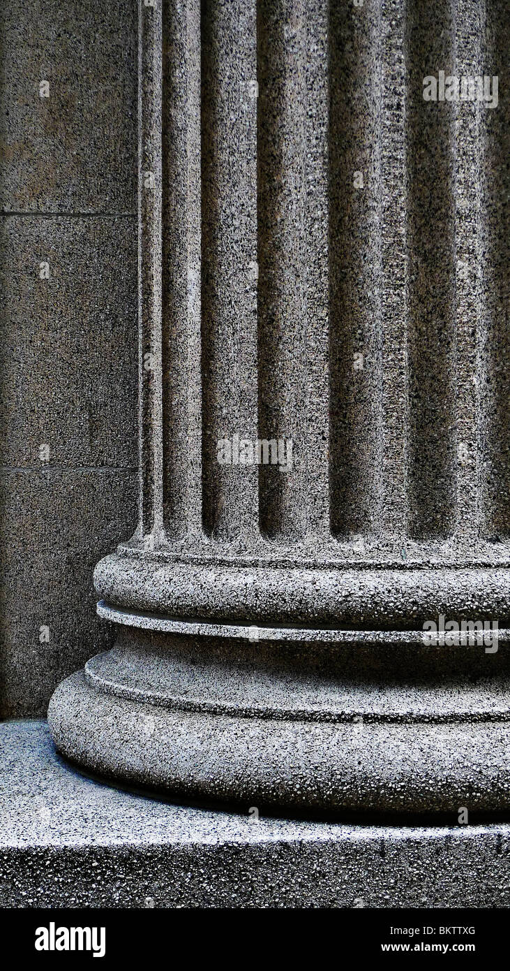 Close-up of a strong supportive architectural pillar base. - Stock Image